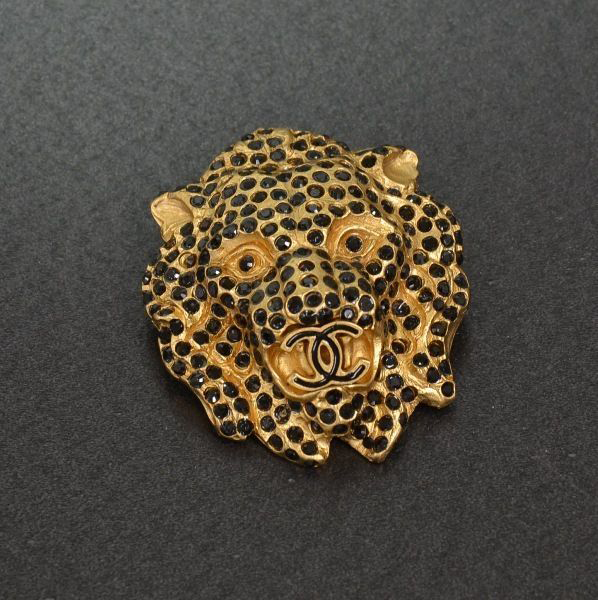 Chanel Gold Tone Lion Motif Black Line Stone Brooch
