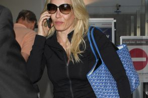 Chelsea Handler travels with a Goyard tote bag
