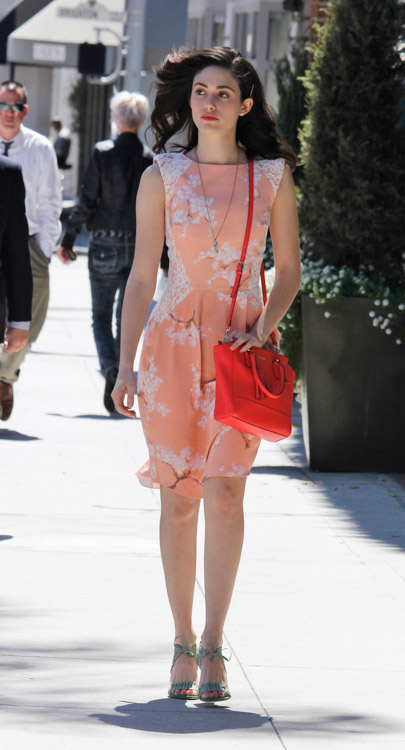 Emmy Rossum carries a Coach Legacy Mini Tanner Crossbody Bag in bright pink (3)