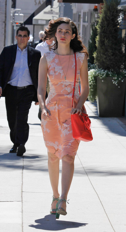Emmy Rossum carries a Coach Legacy Mini Tanner Crossbody Bag in bright pink (2)