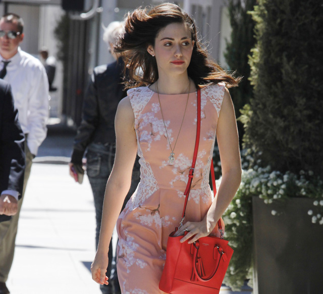 Emmy Rossum carries a Coach Legacy Mini Tanner Crossbody Bag in bright pink (5)
