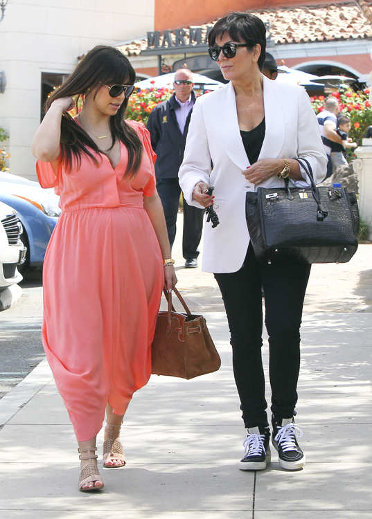 Kim Kardashian carries an Hermes Grizzly Suede Birkin and Kris Jenner carries an Hermes Crocodile Birkin (3)