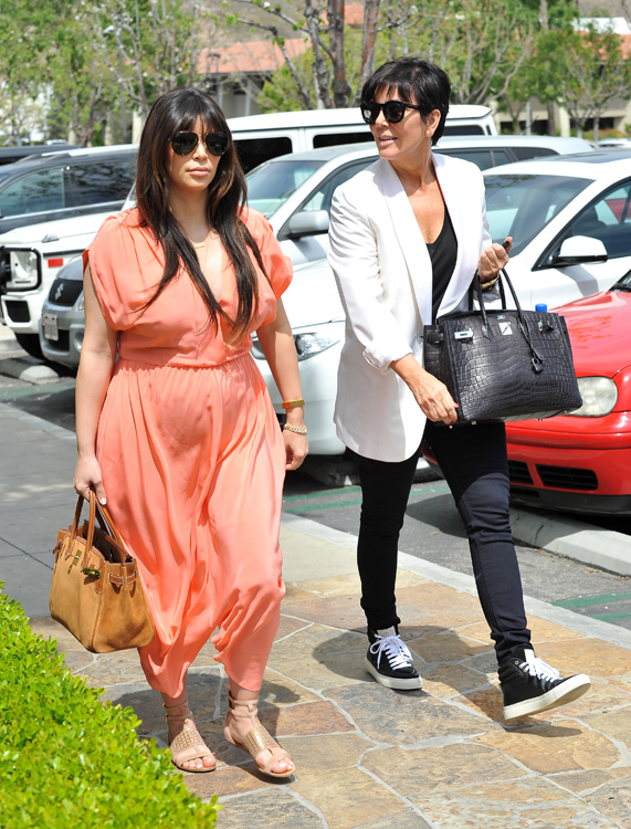 Kim Kardashian carries an Hermes Grizzly Suede Birkin and Kris Jenner carries an Hermes Crocodile Birkin (4)