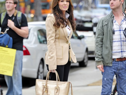 Lis Vanderpump carries a gold Alexander McQueen Whipstitched Tote while scouting a new restaurant location in West Hollywood (5)