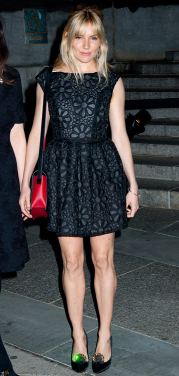 Sienna Miller carries a red and black Delvaux Madame Bag to a Vanity Fair party (3)