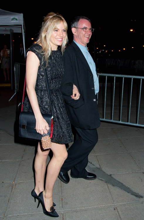 Sienna Miller carries a red and black Delvaux Madame Bag to a Vanity Fair party (2)