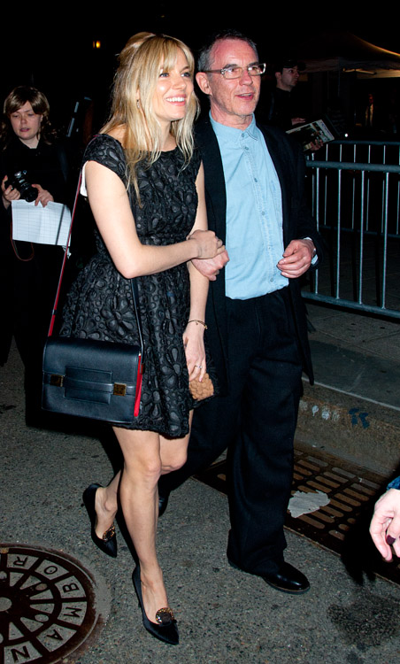 Sienna Miller carries a red and black Delvaux Madame Bag to a Vanity Fair party (4)