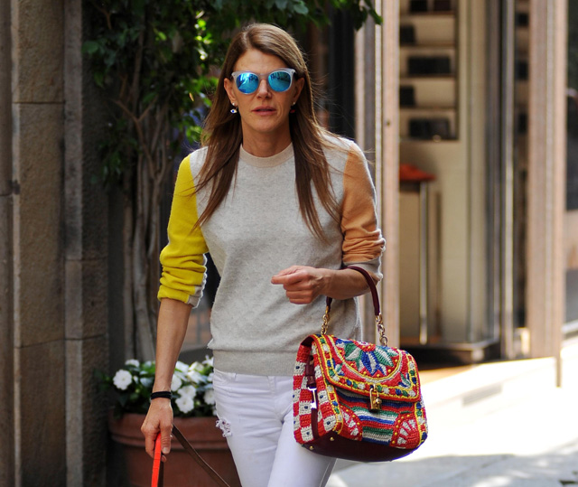 Anna Dello Russo carries a Dolce   Gabbana Miss Dolce Woven Raffia Bag  while walking her d47845f5337a0