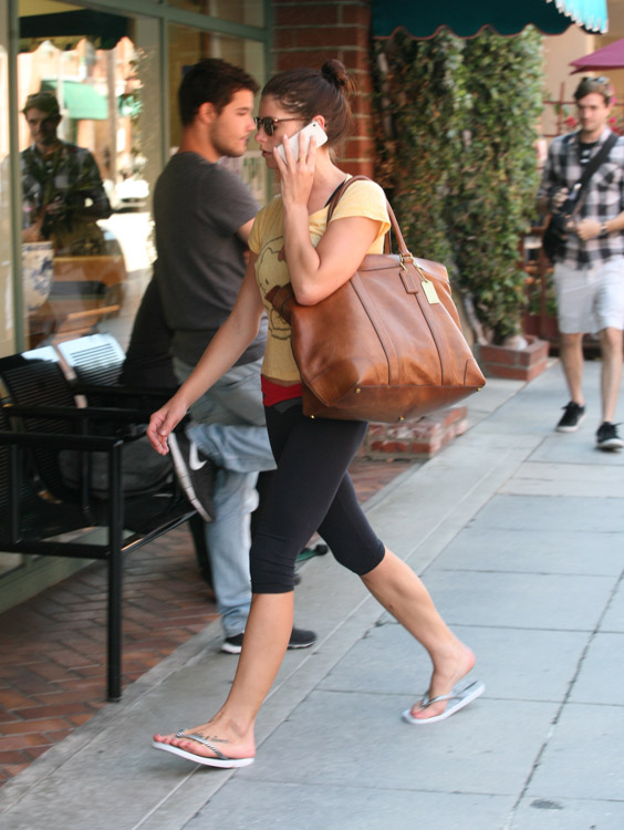 Ashley Greene carries a Coach Bleecker Legacy Weekend Tote (1)