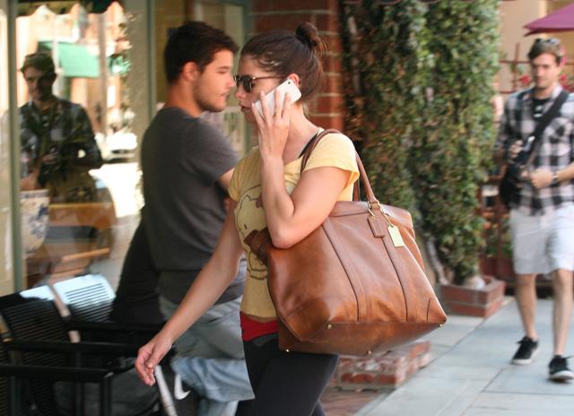 Ashley Greene carries a Coach Bleecker Legacy Weekend Tote (5)