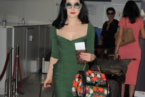 Dita Von Teese and Her Dolce & Gabbana Bag Look Perfect at the Airport