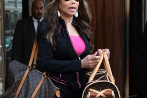LaToya Jackson totes her furry friend in Louis Vuitton