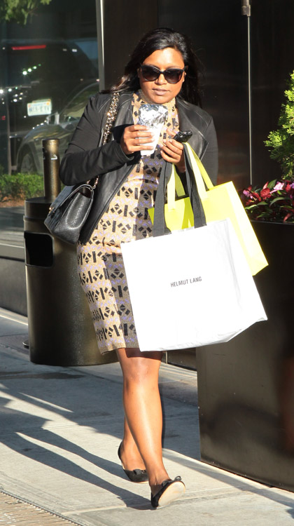 Mindy Kaling carries a black Chanel Classic Flap Bag in New York City (3)