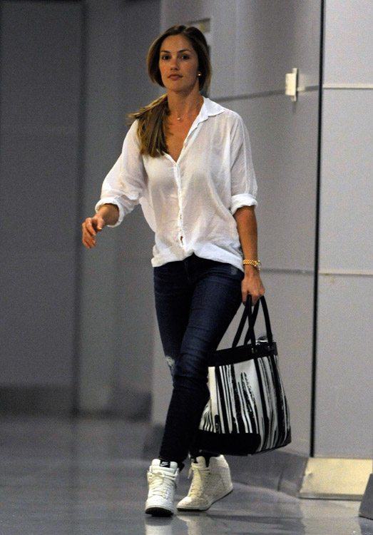 Minka Kelly carries a Coach x Krink Weekend Tote at LAX (2)