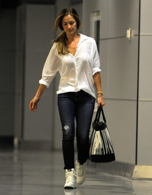 Minka Kelly carries a Coach x Krink Weekend Tote at LAX (1)