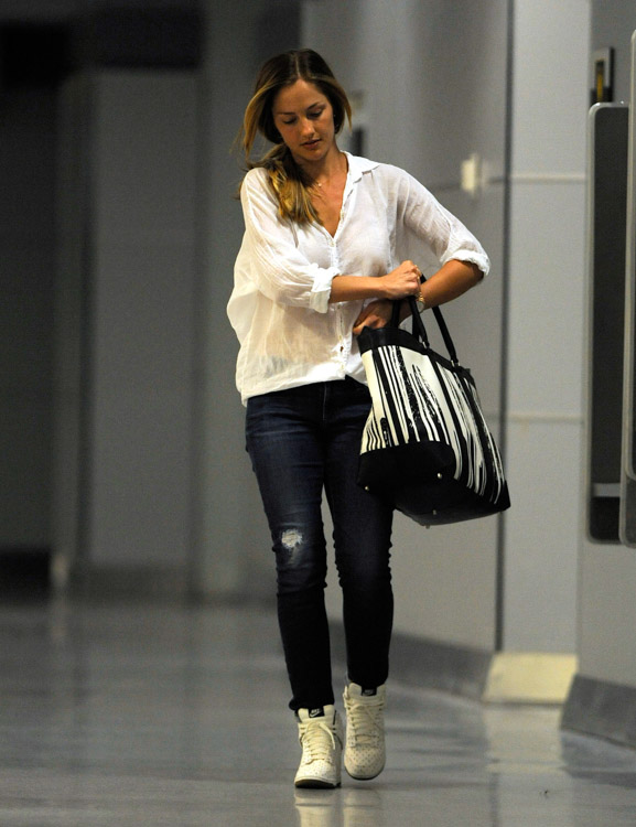 Minka Kelly carries a Coach x Krink Weekend Tote at LAX (4)