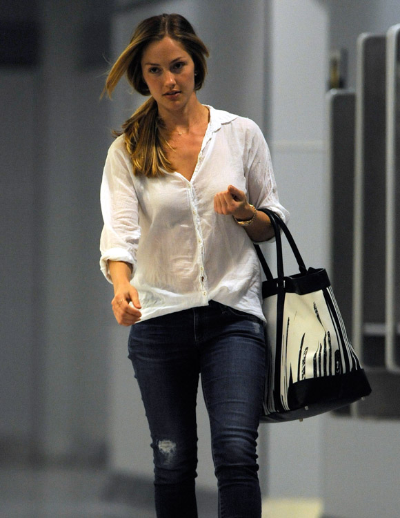 Minka Kelly carries a Coach x Krink Weekend Tote at LAX (3)