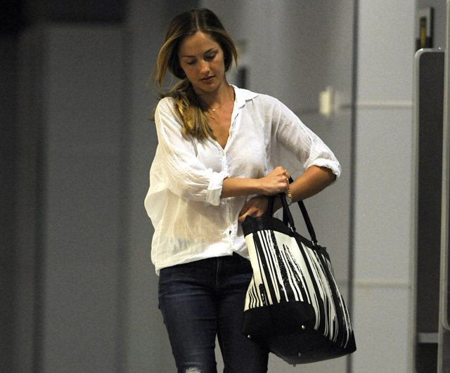 Minka Kelly carries a Coach x Krink Weekend Tote at LAX (5)