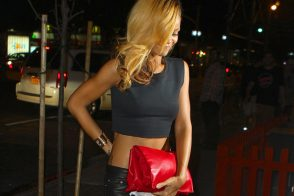 Rihanna loves her red Celine Roll Clutch