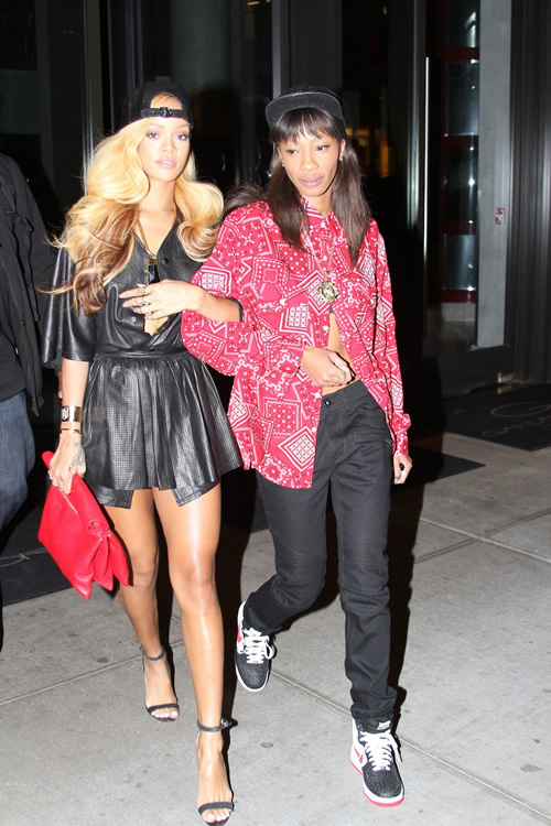 Rihanna and her Celine Roll Clutch1