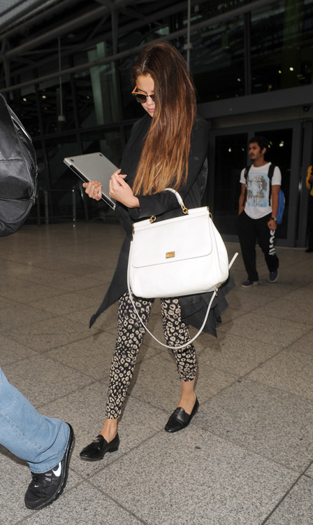Selena Gomez carries a white Dolce & Gabbana Miss Sicily Bag (2)