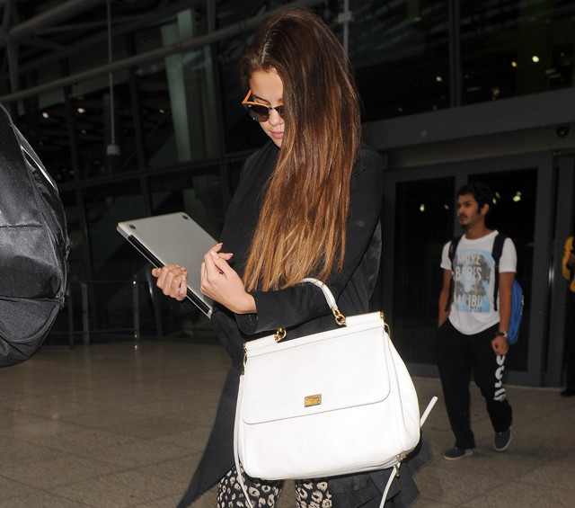 decd3aedf8c6 Selena Gomez carries a white Dolce   Gabbana Miss Sicily Bag ...