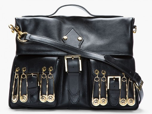 """Fill in the Blank: """"____ should carry the Versus Gold Pin Shoulder Bag."""""""