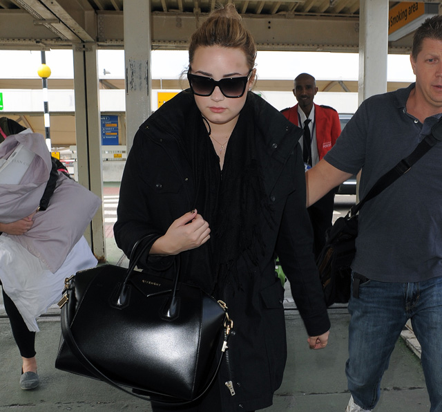 05c8036ae4 Demi Lovato carries a black Givenchy Antigona Bag in London (5)