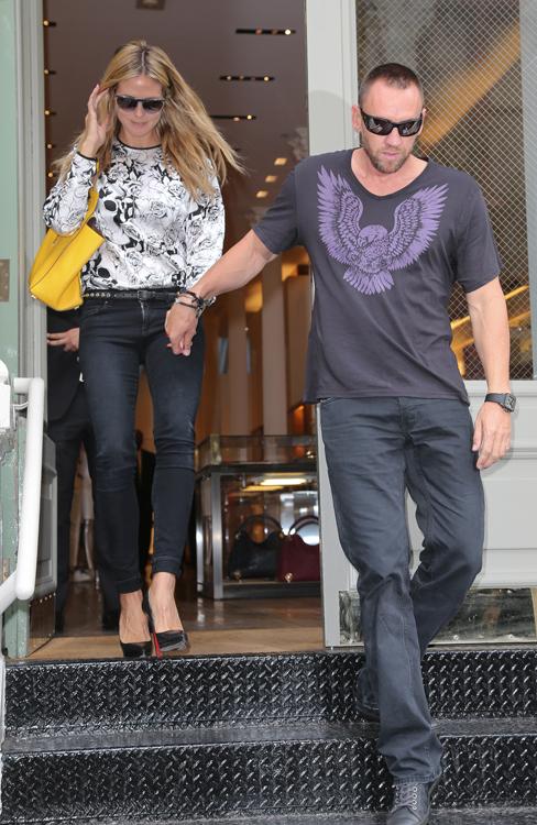 Heidi Klum carries a Michael Kors Miranda Tote in yellow. (1)