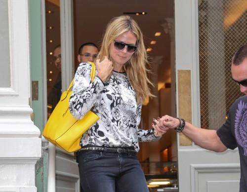 Heidi Klum carries a Michael Kors Miranda Tote in yellow. (3)