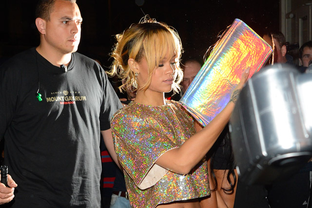 Rihanna carries a Stella McCartney Holographic Clutch in London. (1)
