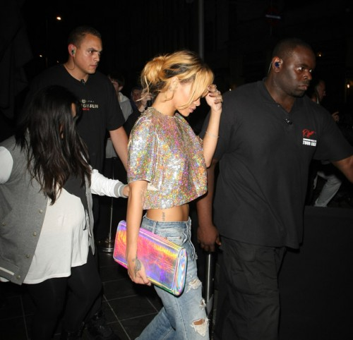 Rihanna carries a Stella McCartney Holographic Clutch in London. (3)