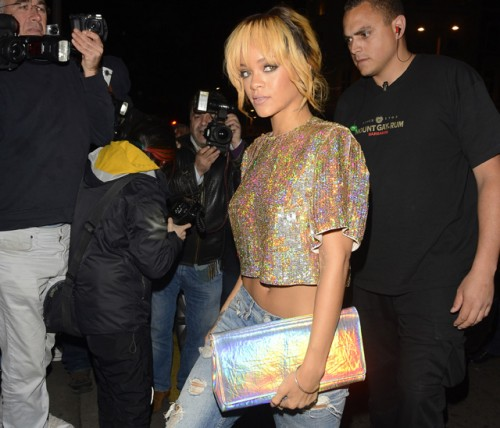 Rihanna carries a Stella McCartney Holographic Clutch in London. (5)