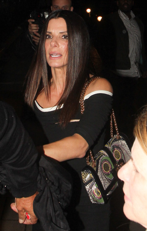 Sandra Bullock carries a Christian Louboutin Sweet Charity Snakeskin Bag in London (1)