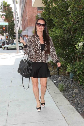 Kyle Richards carried an embroidered black Valentino Rockstud Tote in LA (2)