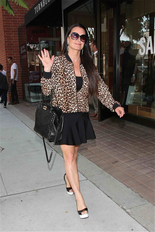 Kyle Richards carried an embroidered black Valentino Rockstud Tote in LA (1)