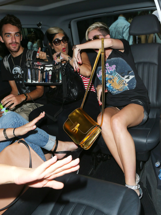 Miley Cyrus carries a gold Celine Classic Box Bag in London (1)