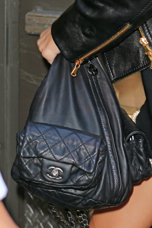 83a28a91d9a1 Miley Cyrus carries a black Chanel backpack in NYC (4) - PurseBlog