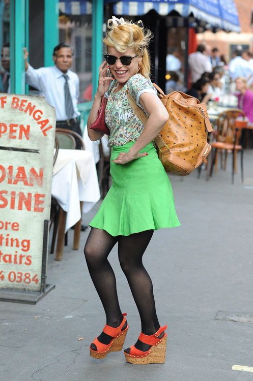 Paloma Faith carries an MCM logo backpack in London (2)