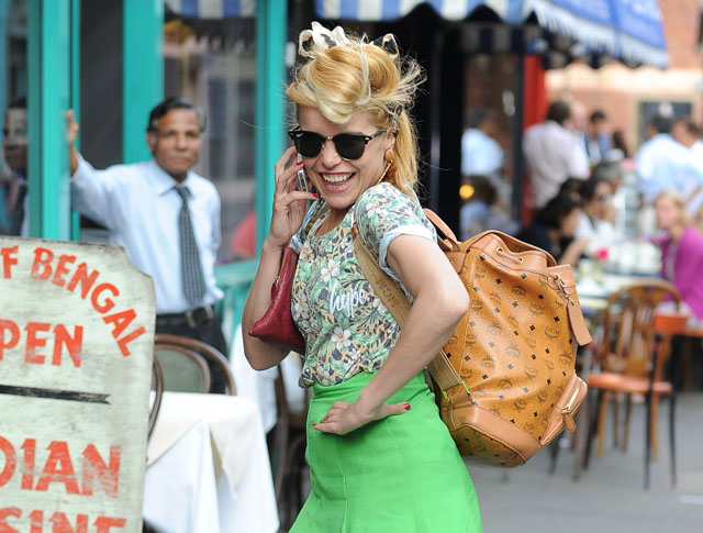 Paloma Faith carries an MCM logo backpack in London (5)