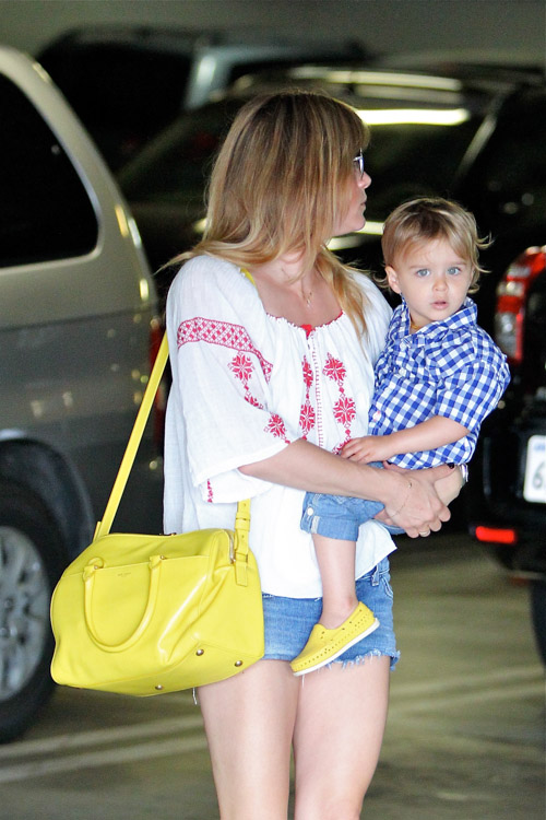 Selma Blair carries a yellow Saint Laurent Classic Duffel Bag (1)
