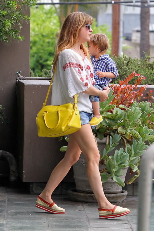 Selma Blair carries a yellow Saint Laurent Classic Duffel Bag (3)