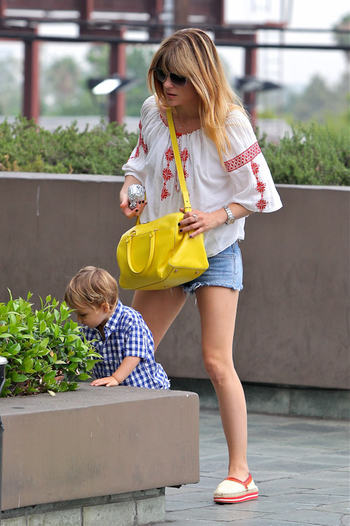 Selma Blair carries a yellow Saint Laurent Classic Duffel Bag (4)