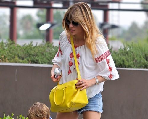 Selma Blair carries a yellow Saint Laurent Classic Duffel Bag (5)