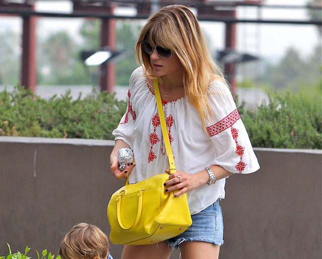 Selma Blair carries a yellow Saint Laurent Classic Duffel Bag (5) ce8686f964e90