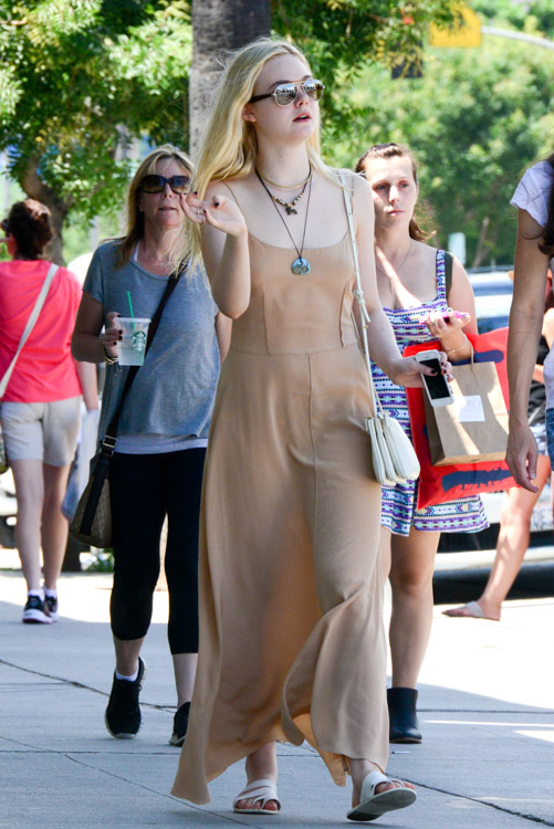 Elle Fanning carries an ivory Celine Trio Bag (2)