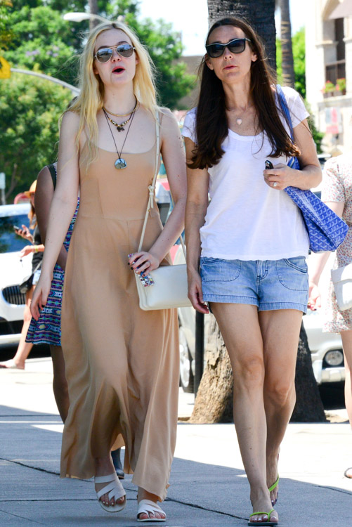 Elle Fanning carries an ivory Celine Trio Bag (1)