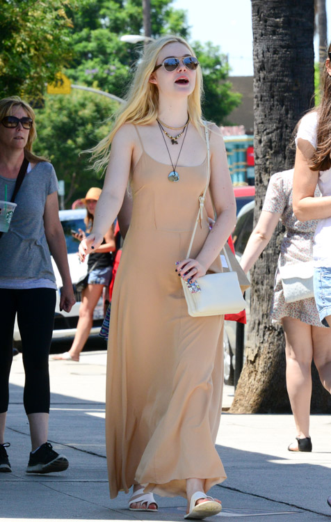 Elle Fanning carries an ivory Celine Trio Bag (3)