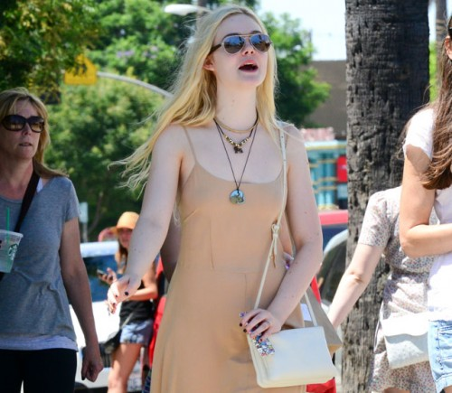 Elle Fanning carries an ivory Celine Trio Bag (5)