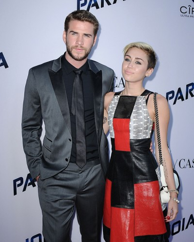 "Miley Cyrus carries a black and white Chanel Boy Bag at the ""Paranoia"" premiere (2)"